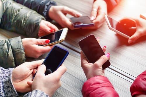 Teens using their mobile phones