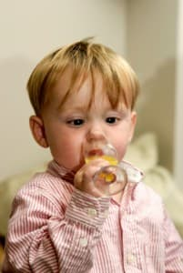 Baby boy drinking alcohol