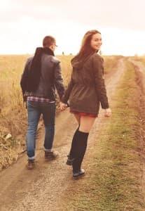 Drunken couple walking through a mud road