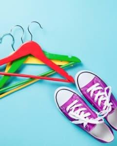 Teens sneakers and hangers-on the floor