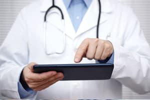 doctor choosing treatment options on ipad